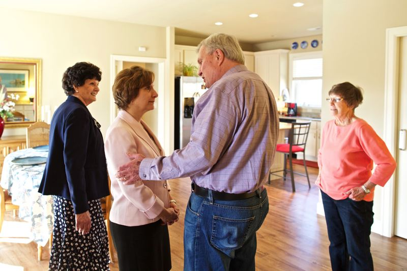 TIMES PHOTO: JAIME VALDEZ - Congresswoman Suzanne Bonamici visits Dick Bech at  and his wife, Sharon, right, who live with their daughter, Kim, at their home at the Edwards Center at Aloha.