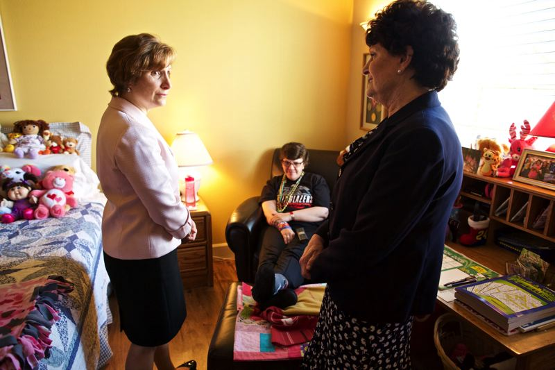 TIMES PHOTO: JAIME VALDEZ - Congresswoman Suzanne Bonamici talks with Dr. Jean Edwards, founder of the Edwards Center, in the room of Kim Bech, who shares a home with her parents, Dick and Sharon.