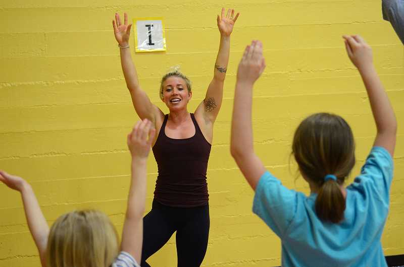 TIDINGS PHOTO: VERN UYETAKE - Local businesses volunteered their time to lead exercises during the Family Fit Night.