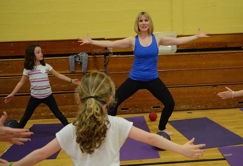 TIDINGS PHOTO: VERN UYETAKE - An exercise circuit and nutrition booths were two main attractions at Sunset's Family Fit Night Friday, April 1.