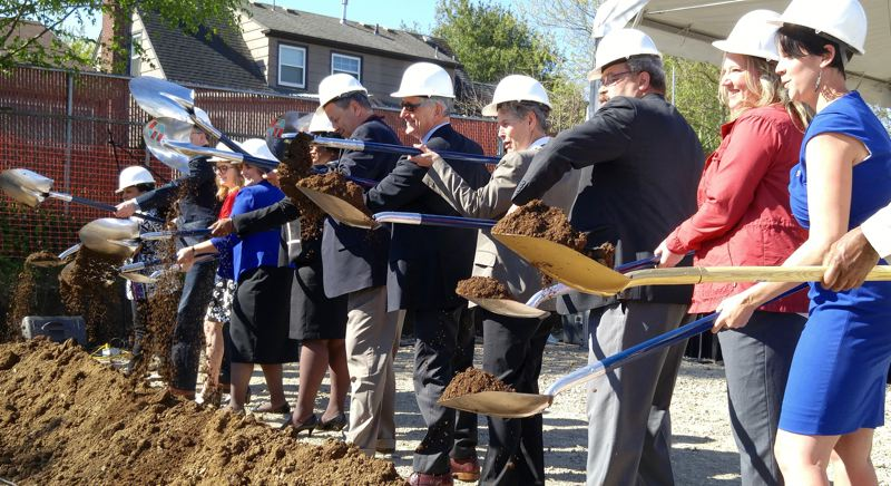 TRIBUNE PHOTO: CHRISTOPHER KEIZUR - The first official groundbreaking on the Faubion and Concordia joint school building that will be completed by the fall of 2017.