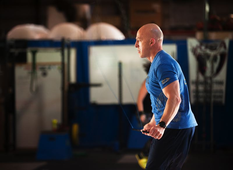 OUTLOOK PHOTO: JOSH KULLA - Capt. Claudio Grandjean, 52, works out at a Gresham-area crossfit gym, where he also teaches classes. Working out regularly helped him stay on the Gresham Police Departments SWAT team for 20 years.