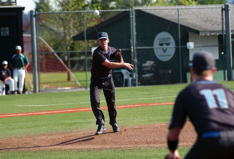 DAN BROOD - Lakeridge junior pitcher Everest Webster throws a pitch to first base after fielding a bunt in Friday's game.