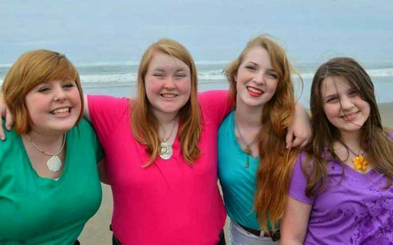 COURTESY PHOTO - The Cadd sisters of Forest Grove -- Amie Cadd Musselwhite, Jessica Cadd, Stephanie Cadd and Samantha Cadd -- posed for a photo during a trip to the Oregon Coast in 2013.