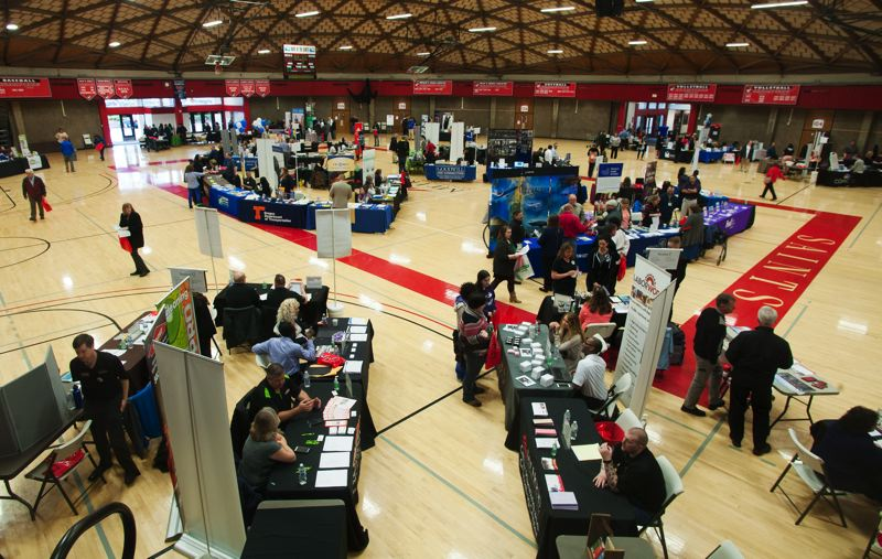 OUTLOOK PHOTO: JOSH KULLA - More than 100 companies and government agencies spent four hours at Mt. Hood Community College on Thursday recruiting prospective workers. The fair was the colleges largest by 20 percent.