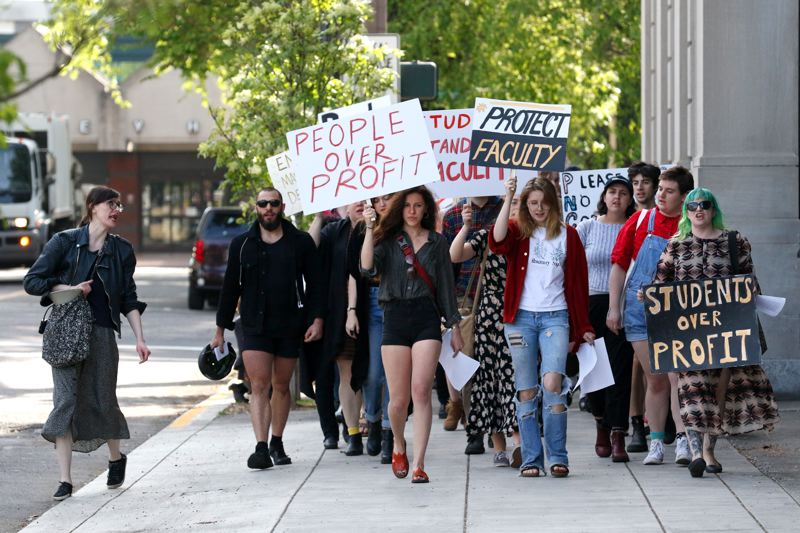 TRIBUNE PHOTO: JONATHAN HOUSE - Protestors took to the streets on Monday, alleging unethical labor practices at the Pacific Northwest College of Art.