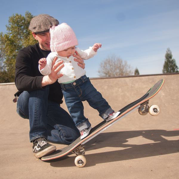 OUTLOOK PHOTO: JOSH KULLA - Tyler Cole is working to have a new skate park built in Troutdale. Until then, he often travels with his 8-month-old daughter, Annabelle, to the Gresham skate park near Main City Park.