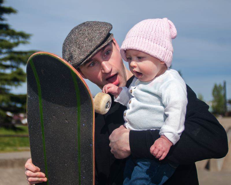 OUTLOOK PHOTO: JOSH KULLA - Tyler Cole and his daughter Annabelle enjoy a laugh during a recent morning session at Greshams skate park.