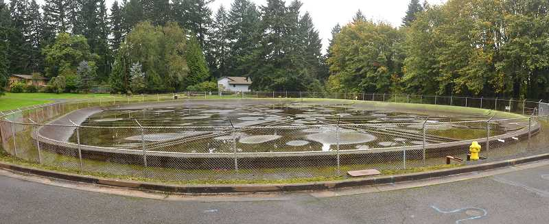 TIDINGS FILE PHOTO: VERN UYETAKE - A key selling point for West Linn in approving the project was a $5 million payment to go toward construction of a new Bolton Reservoir. Pictured here, the old 100-plus year old reservoir was cracked and had been slated for replacement since the 1980s.
