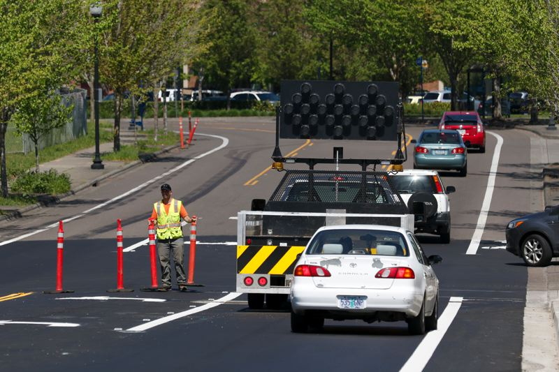 TIMES PHOTO: JONATHAN HOUSE - Beaverton city workers removed traffic cones to officially open Southwest Hocken Avenue across a new bridge on Tuesday.
