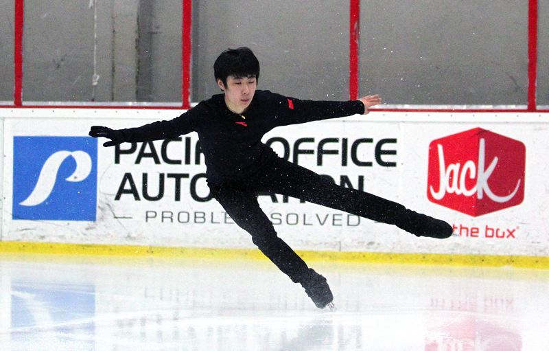 TIMES PHOTO: MILES VANCE - Chinese figure skater Jin Boyang, currently one of the top-ranked mens figure skaters in the world, completes a jump during a workout at the Winterhawks Skating Center in Beaverton on Tuesday.