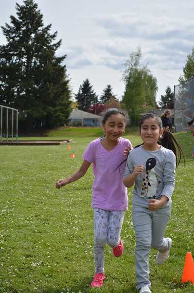 HILLSBORO TRIBUNE PHOTOS: KATHY FULLER - Members of W.L. Henry Elementary Schools running club are all smiles after a quick water break last Friday afternoon.