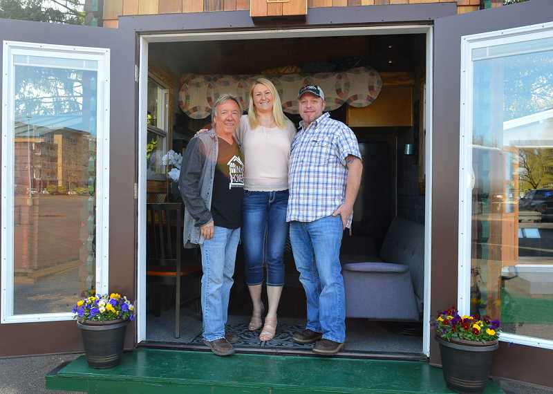 SPOKESMAN PHOTO: JAKE BARTMAN - From left: Ron Blair, owner of Global Green Concept Designs; Taya Hill and Patrick Vercoe, owner of Harborside RV & Marine Featuring Tiny Homes.