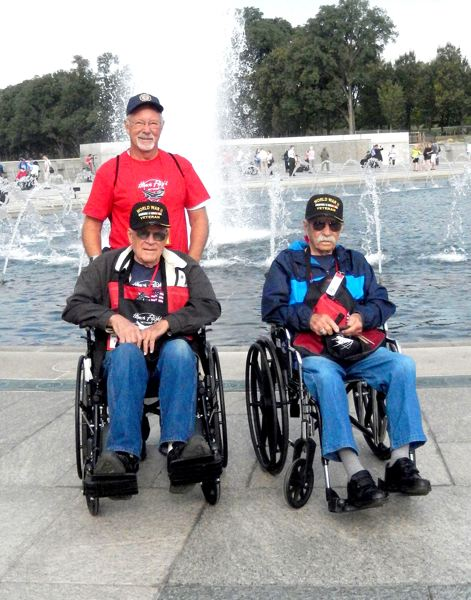 PAMPLIN MEDIA GROUP FILE PHOTO: HOLLY GILL - Henry Nelsen, 88, left, and Herman Hansen, 87, both from Madras, were among 50 World War II veterans who participated in a 2014 Honor Flight to Washington, D.C. Tom Brown of Madras, who paid his own way on the trip, was the team leader for a group of nine veterans who visited the Lincoln Memorial Reflecting Pool.