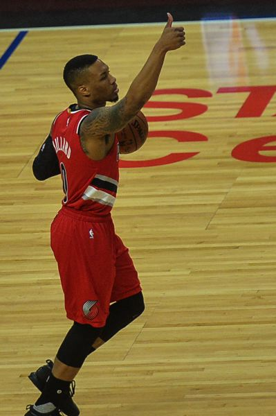 TRIBUNE PHOTO: MICHAEL WORKMAN - The Trail Blazers and guard Damian Lillard get a thumbs-up for their fourth-quaarter performance in winning Game 5 at Los Angeles.