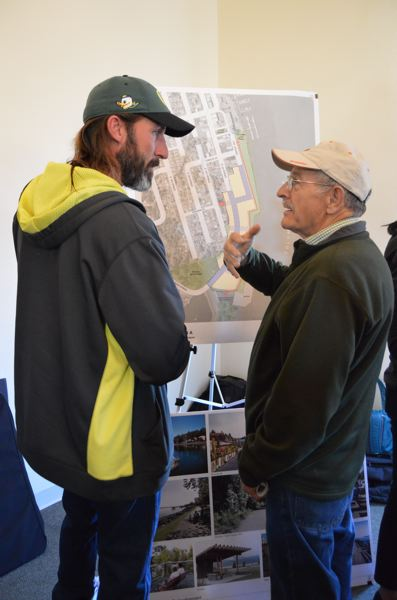 SPOTLIGHT PHOTO: NICOLE THILL - Rick Scholl, a St. Helens resident, and Don Parrett, a Columbia City resident, discuss how the waterfront could be used to attract people all year long.