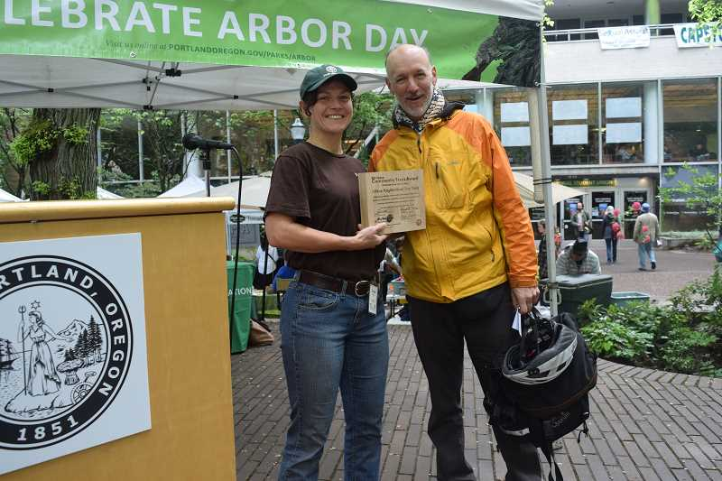 DANIEL PEARSON - Jennifer Karp holds a plaque with Matt Morrissey, a member of the Albina Neighborhood Tree Team. The neighborhood group is recognized as the 2016 Maynard Drawson Memorial Award winner for a group effort.