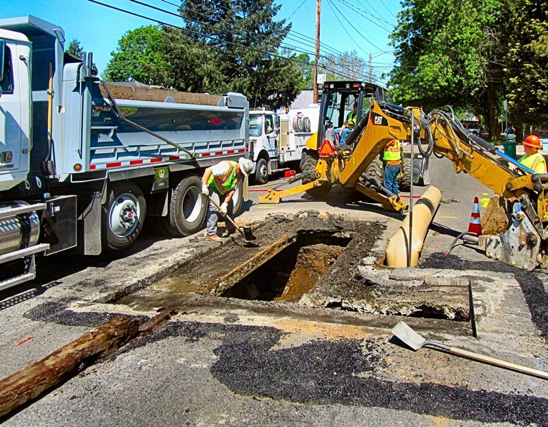Emergency repairs to sinkhole on Milwaukie Ave