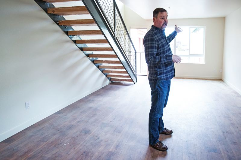 PORTLAND TRIBUNE: JONATHAN HOUSE - Home First co-owner Rob Justus talks about his new low-income housing development in one of the new apartments.