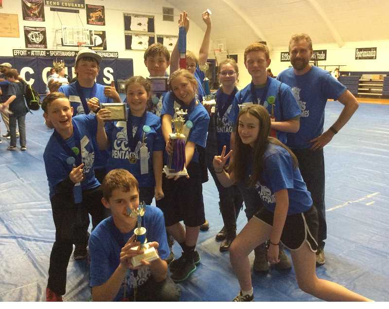 PHOTO COURTESY OF LAURIE HOLLIS - The Crook County Middle School Pentagames team took first place at the annual competition held April 22 in Echo. Several individuals also placed. Pictured back row, left, Nathan 'Bubba' Luttrell, Waylon Gray, Zephaniah Portukalian, Jenna Porter, Aiden Rictor and CCMS teacher Matt Fischer. Front row, Casey Hewitt, Abbigail Chaney, Alayna Denney and Hannah Dozhier. Kneeling, Xavier Layne.