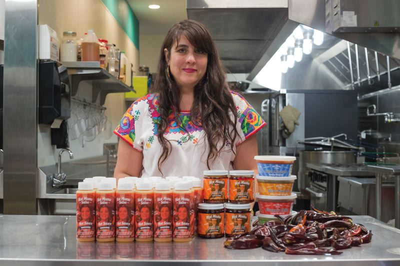 PAMPLIN MEDIA GROUP: JONATHAN HOUSE - Hot Mama Salsa's Nikki Guerrero at her Northeast Portland kitchen.