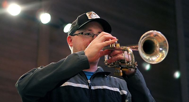 TIMES PHOTO: MILES VANCE - Trumpet player Thomas Barber works through a Tuesday rehearsal - led by ISing Choir Conductor and Artistic Director Stephen Galván - for Divine Jazz, which opens Friday at Bethel United Church of Christ in Beaverton.