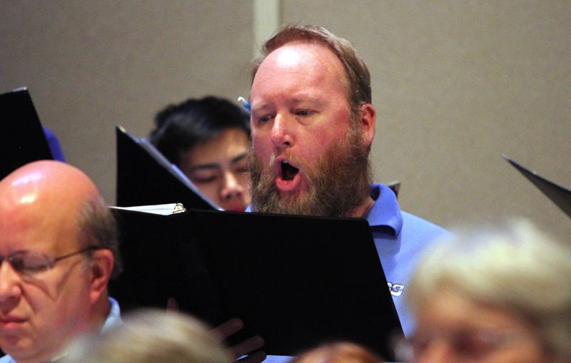 TIMES PHOTO: MILES VANCE - Baritone Kirk Hansen returns to performance with the ISing Choir after recovering from surgery for a brain tumor back in September. ISings Divine Jazz opens Friday at Bethel United Church of Christ in Beaverton.
