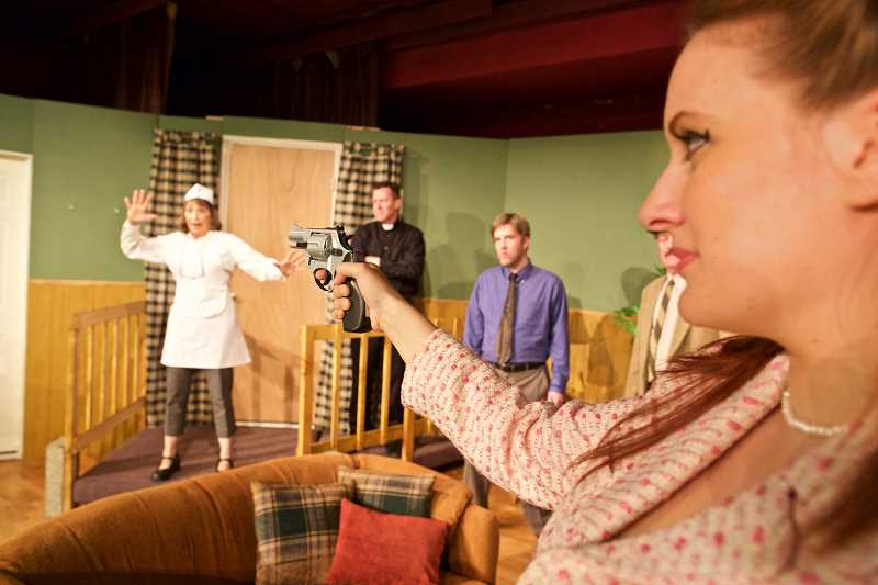 TIMES PHOTO: JAIME VALDEZ - Jayne Furlong, lead actress portraying Elizabeth in the play Catch Me if You Can, holds a gun towards Diana LoVerso, Sydney, during rehearsal of Mask & Mirror community theaters new play at Calvin Presbyterian Church.