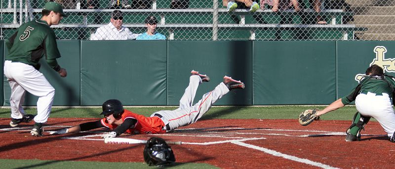 TIMES PHOTO: MILES VANCE - Beaverton's Karac Leyva slides home to score in his team's 4-3 loss to Jesuit at Jesuit High School on Friday.