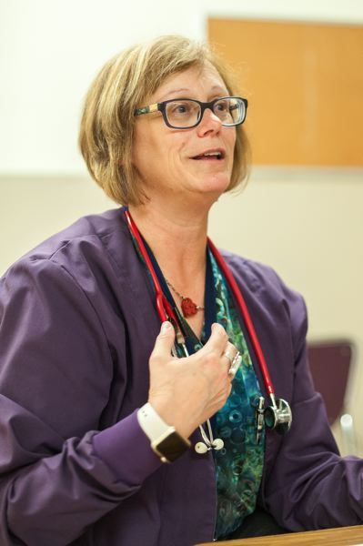 TRIBUNE PHOTO: JOSHUA KULLA - Multnomah Eduation Service District nurse Laurie Coe talks about her passion for school nursing in her office at Reynolds Middle School.