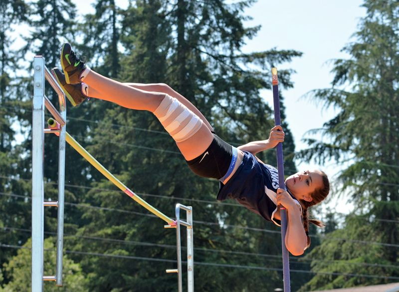 SPOTLIGHT PHOTO: JAKE MCNEAL - Kylie Wells of Banks competes in the pole vault during the Cowapa League district track and field meet at St. Helens High School on Friday.
