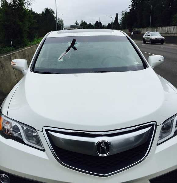 COURTESTY OF BEAVERTON POLICE DEPARTMENT - A sharp piece of metal flew into a vehicle's windshild and lodged in the top of the dashboard, narrowly missing the teenaged girl in the passenger seat. She was not seriously injured.