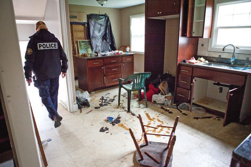 TRIBUNE PHOTO: ADAM WICKHAM - The smell from squatters feces and urine sends Portland police out of this house coughing and gagging, not an uncommon scenario, they say.