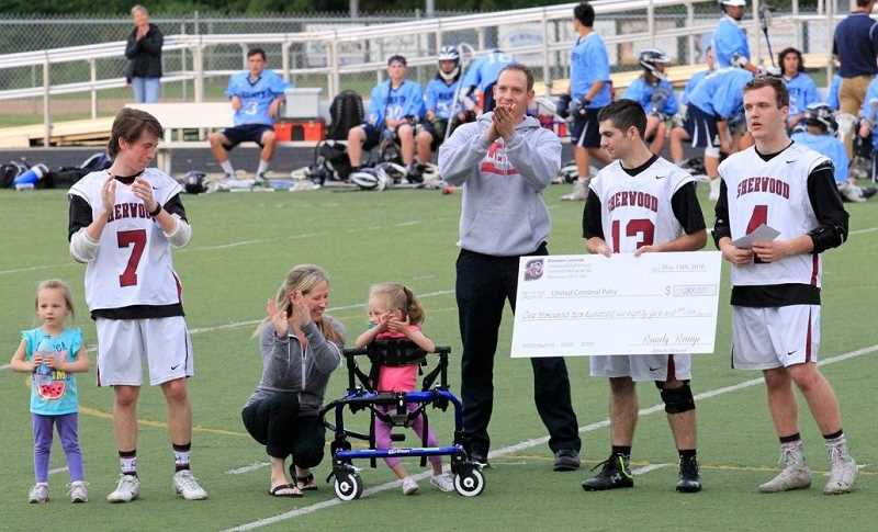 COURTESY OF AIME DAVIS - The Bowmen lacrosse team presented a check to Lisa Ledson, who accepted it on behalf of United Cerebral Palsy on May 13. Those in attendence included, from left, Kate Ledson, Zack Brown, Lisa Ledson, Hannah Ledson, Chad Ledson, Brad West and Cam Allender.