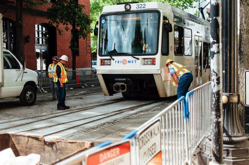 COURTESY PHOTO: TRIMET - TriMet crews checked as a train rolled on replaced track on Southwest First Avenue Friday, May 20. The two-week replacement project is just about finished, and trains will return to regular schedules on Sunday, May 22.