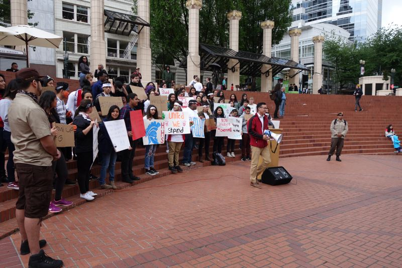 JOSEPH GALLIVAN - Students from United We Stand Oregon at a rally at Pioneer Courthouse Square May 22 2016, sparked by protests against a banner reading Build a Wall.