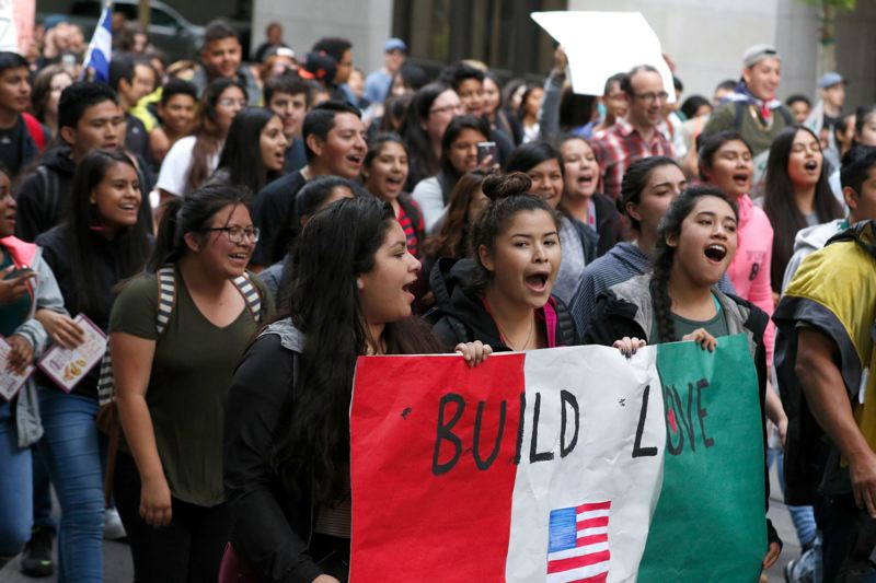 TRIBUNE PHOTO: JONATHAN HOUSE - Students from Portland schools left class and rallied Monday, May 23, at City Hall to protest a 'build-a-wall' banner hung last week at Forest Grove High School.