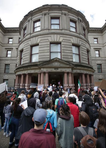 TRIBUNE PHOTO: JONATHAN HOUSE - Portland students rallied at City Hall May 23 to counter a message sent last week when a student draped a 'build-a-wall' at Forest Grove High School.