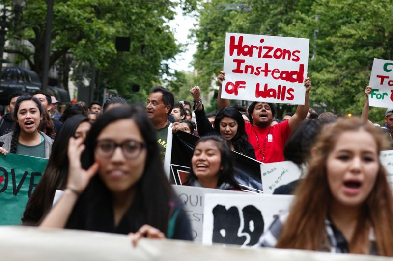 TRIBUNE PHOTO: JONATHAN HOUSE - Portland students marched through downtown Portland May 23 to protest the message behind a 'build-a-wall' banner hung at Forest Grove High School.