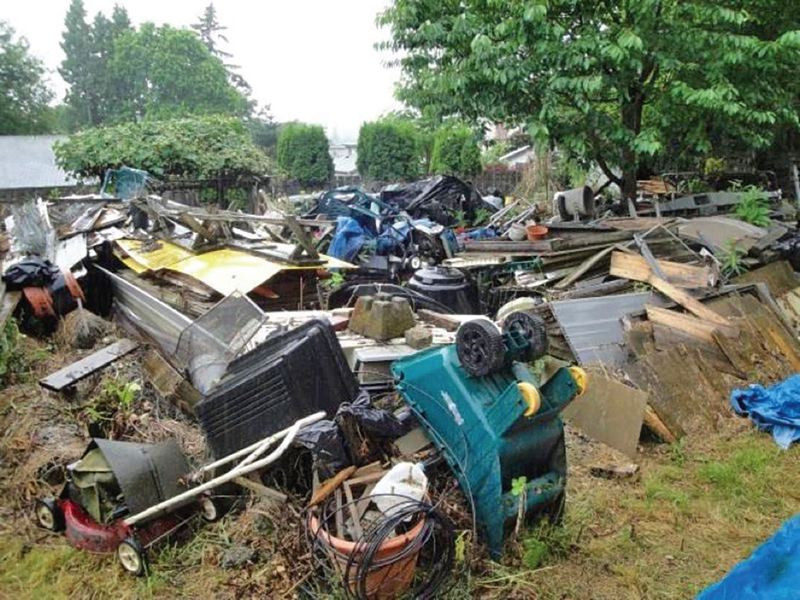 COURTESY CITY OF MILWAUKIE - Milwaukie city staff needed four days and 20 truckloads to clear the junk from a property where Norman Yee was a resident, including 10 riding lawn mowers and 81 pieces of gas-powered lawn equipment.