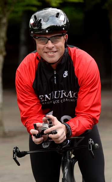 REVIEW PHOTO: VERN UYETAKE - Lake Oswego triathlete Randy Leach is training for the Ironman Couer d'Alene, which includes a 2.4-mile swim, a 112-mile bike ride and a full 26.2-mile marathon.