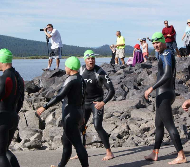 SUBMITTED PHOTO - Randy Leach gives a thumbs-up before entering the water for the swim portion of the 2013 Pacific Crest Long Distance Triathlon. This time, his wetsuit was not on backwards.
