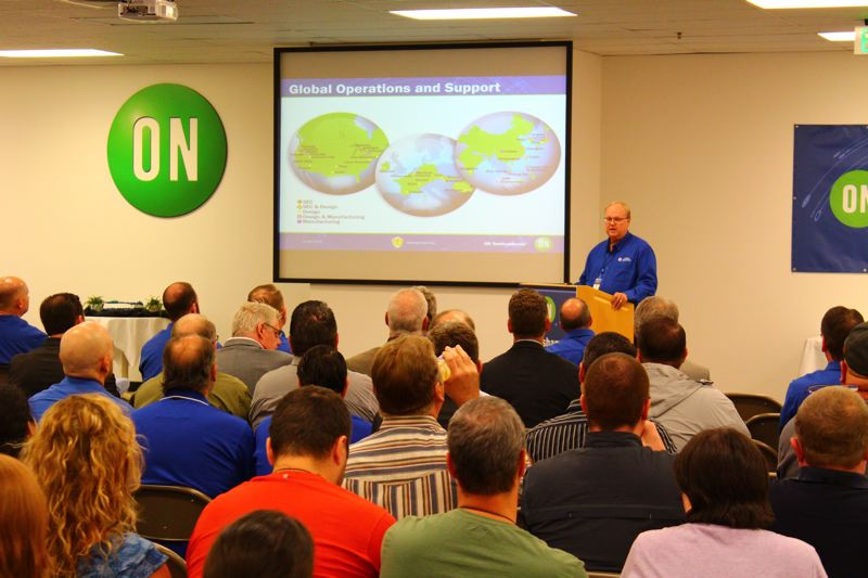 CONTRIBUTED PHOTO: ON SEMICONDUCTOR - ON Semiconductor Chief Executive Officer Keith Jackson addresses an audience that gathered on Friday, May 20, to celebrate the 10-year anniversary of the Gresham wafer fabrication facility.