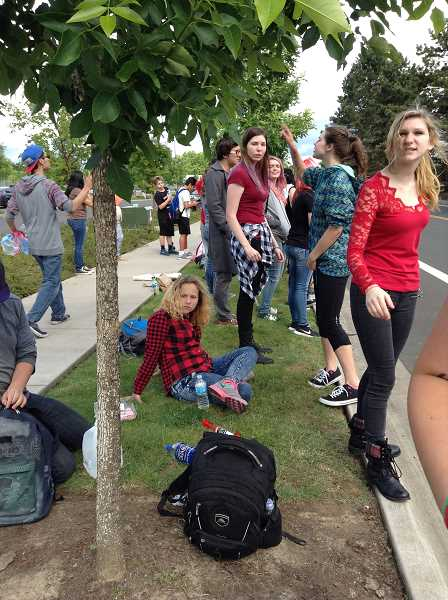 COURTESY PHOTO - About 15 students from Glencoe High marched all the way to Forest Grove High School May 19 to show their support. When they arrived and were not allowed on campus, they decided to stay and await the end of the school day.