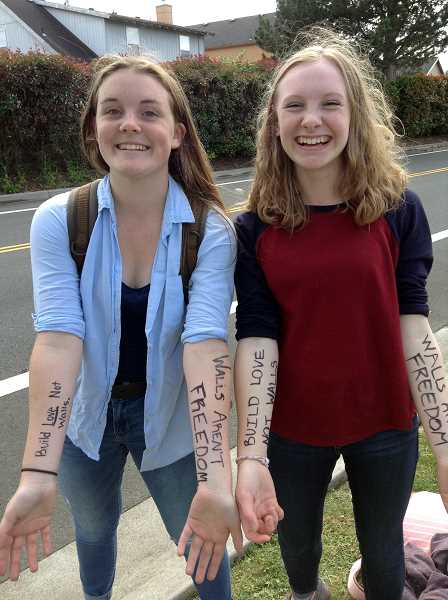COURTESY PHOTO - Glencoe sophomores Grace Simantel and Laura Parrett display the slogans of the day on their arms -- 'Walls Aren't Freedom' and 'Build Love, Not Walls.'