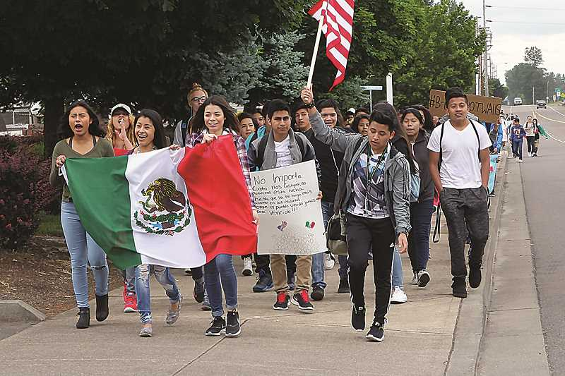 TYLER FRANCKE - More than 100 Woodburn High School students participated in a walkout Wednesday morning.
