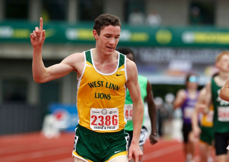 TIDINGS PHOTO: JONATHAN HOUSE - Roman Ollar celebrates moments after winning the state championship in the 1500 at the state track meet in Eugene. Ollar was also second in the 3000.