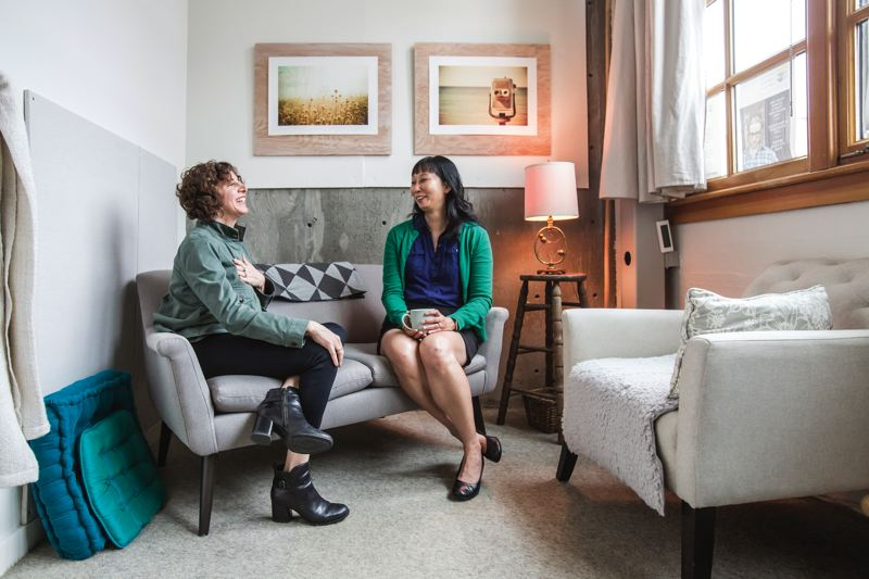 TRIBUNE PHOTO: JONATHAN HOUSE - Business coach Michele Greco (L) chats with her client Cathy Chang at the Portland Coaching Collective in SE Portland. Chang, a writer and editor, sought help with her self doubts when she went into business.