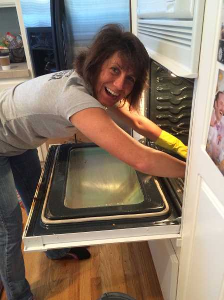 SUBMITTED PHOTO - Volunteer Dawn Pec cleans the oven of a Michelle's Love mom.