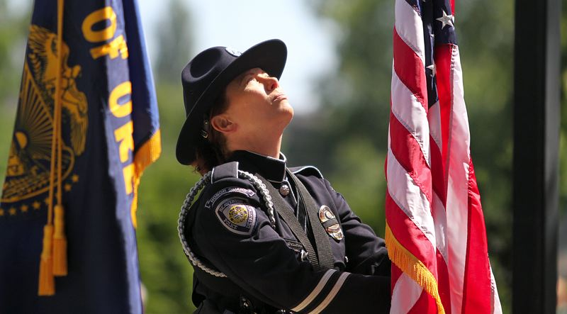 TIMES PHOTO: MILES VANCE - Members of the Beaverton Police Department's Honor Guard, including Misha Sashayvich, presented the colors at Veterans Memorial Park in Beaverton during Monday's Memorial Day celebration.